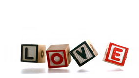Building blocks spelling out love falling and bouncing Stock Photography