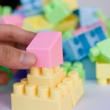 Building blocks toy. People hand building blocks toy royalty free stock photo
