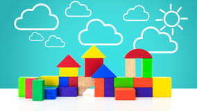 Building blocks toy over floor. With cloud and sun background Stock Image