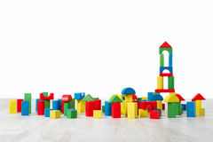 Building blocks toy over floor in white interior. Building blocks toy over floor in white empty interior. Childrenroom design stock photos