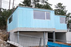 Building with blue Rigid polystyrene panel. For wall insulation on construction site stock photos