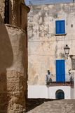Building with blue shutters on a street in the coastal town of Otranto on the Salento peninsula, Puglia, South Italy. stock images