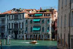 Building and boat on canal in Venice, Italy Stock Photos