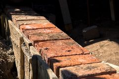 Brick foundation. Building the brick foundation by red bricks Royalty Free Stock Images