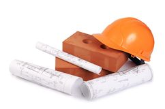 Building brick with a helmet Royalty Free Stock Photos