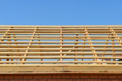 Building a brick house roof. The construction of wooden rafters Stock Photos