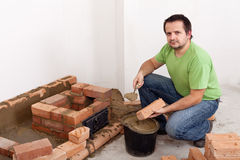 Building a brick stove Stock Image