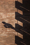 Building brick wall with shadows in verical format Royalty Free Stock Image