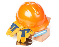 Building bricks, hard hat, trowel and gloves Stock Images