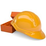 Building bricks and helmet Stock Photo