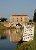 Building bridge reflected on the River Brenta, Venice, Italy Stock Photos