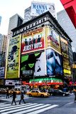 Broadway Billboards. A building on Broadway is covered in show billboards royalty free stock photo