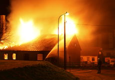 A building burning down. A house in Sweden is burning down during a fire accident Royalty Free Stock Image