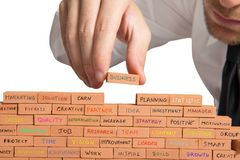 Building a business. Businessman builds a new business with brick stock photography