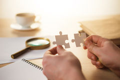 Building a business success. The hands with puzzles Royalty Free Stock Photo