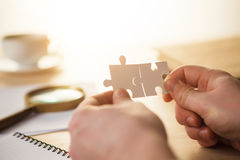 Building a business success. The hands with puzzles Stock Images