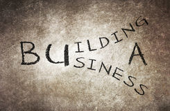Building a business written on a chalkboard Stock Photography