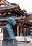 Building and bust of man in Kamakura. Royalty Free Stock Image