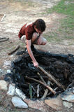 Building campfire. A teen preparing a fire pit for a campfire royalty free stock photography