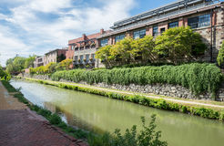 Building by canal. Scene of brick building with tree along side by the canal Royalty Free Stock Image