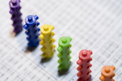 Building capital. Building toy blocks over a financial newspaper Royalty Free Stock Photo