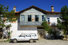 Building and car. White building and car on the street in turkish village, Turkey Stock Photos