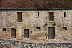 A building in the Castle of Couches. The castle of Couches (also known as Castle of Marguerite de Bourgogne), is registered in conformance with the French Royalty Free Stock Photography