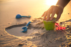 Free Building Castle On Beach With Toy In Sunset Royalty Free Stock Photography - 83988487