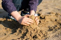 Building castles on the sand by kids. Spring fun at the lake. stock photography