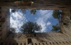 Building castles in the sky. View from the inside, top of the ruins of a medieval castle, with trees growing on the rocks and the sky above. Photo taken from Royalty Free Stock Photos