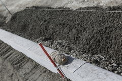 Building cement curb. Building a cement curb and street using string and stakes to level Stock Photo