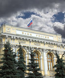 Building of Central Bank of Russia with flag under sky with dark clouds Stock Image