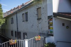Building in central city area still showing signs of damage inflicted by gun fire in the 1993 civil war stock photo