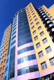 Building Chameleon. Business center. Building Chameleon in bright sunny day Stock Photos