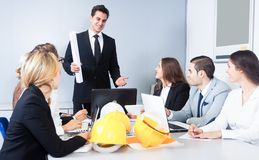 Building chief speech at meeting stock image