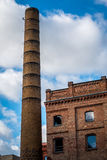 Building with chimney with blue sky and clouds. In Berlin, Germany Royalty Free Stock Photo