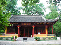 Building Chinese style in garden. Building of Chinese style and green trees in public garden Royalty Free Stock Photo