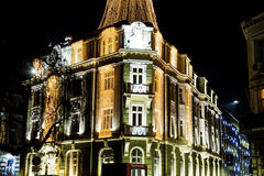 Building with Christmas decoration at night Stock Photography