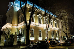 Building with Christmas decoration in Sofia,Bulgaria. SOFIA,BULGARIA-01.12.16 : vintage building with Christmas  with sparkling lights on.Night scene in Sofia Royalty Free Stock Photos
