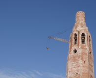 The building of the church.  Elevating crane. Stock Photos