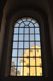 Building through church window. Stock Image