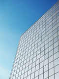 Building in city. Mirror wall of office building in city on a background blue sky Royalty Free Stock Photos
