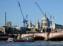 Building the city of London. London ciity skyline filled with cranes Royalty Free Stock Photos