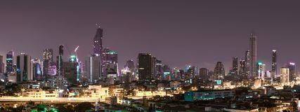 Building city in Bangkok at night time. Concept blue light at city Royalty Free Stock Image