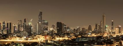Building city in Bangkok at night time. Concept warm light at city Stock Photography
