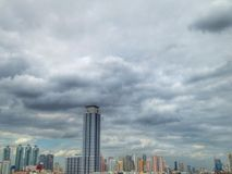 Building. In the city cloud white blue Royalty Free Stock Photo