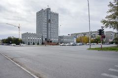 The building of the city Council of Achinsk with cars in front of it. Overcast autumn day. City Achinsk, Krasnoyarsk Territory. Russia. The building of the city Stock Image