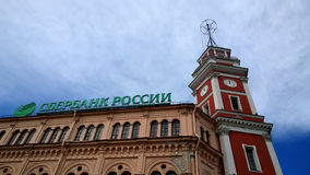 The building of the city Duma in Saint-Petersburg and Sberbank logo on the side house Royalty Free Stock Photography