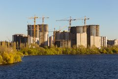 Building of city habitation on big river Stock Image