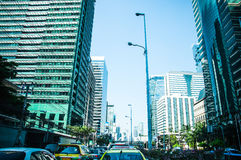 Building in the city and traffic jam on Sathorn road Royalty Free Stock Image